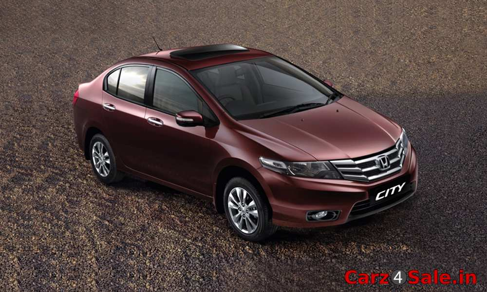 Honda City in Carnelian Red Pearl colour. Honda City V Sunroof AT Picture Galle - Carz4Sale